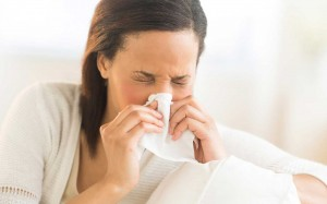 cold-flu-woman-blowing-nose-ftr